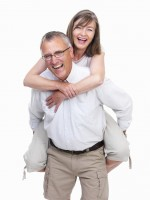 Portrait of a happy old man carrying old woman