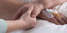 Panorama of female holding cancer patient hand