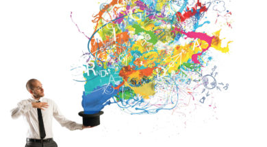 Creative businessman with colors coming out of the hat